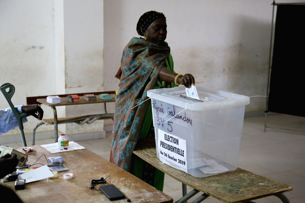 DAKAR, Feb. 24, 2019 - A woman casts her ballot at a polling station in Dakar, Senegal on Feb. 24, 2019. Senegalese presidential election started Sunday at 08:00 local time (08:00 GMT) and 6.68 ... - Idrissa Seck