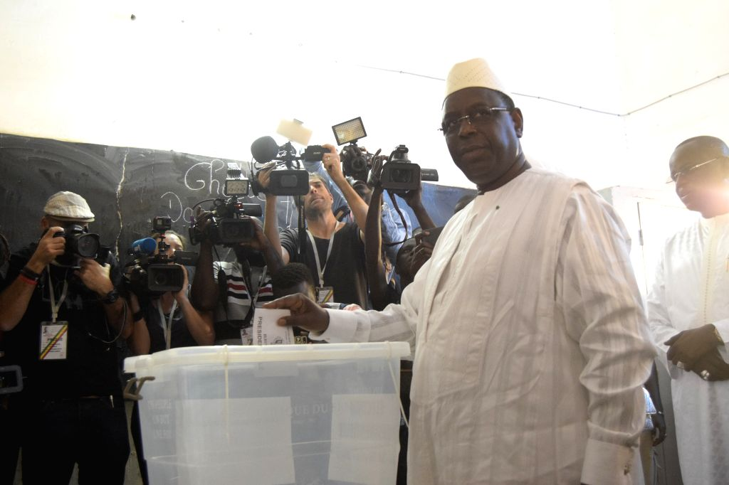 DAKAR, Feb. 24, 2019 - Incumbent Senegalese president Macky Sall votes at a polling station in Fatick, Senegal, Feb. 24, 2019. Senegalese presidential election started Sunday at 08:00 local time ... - Idrissa Seck