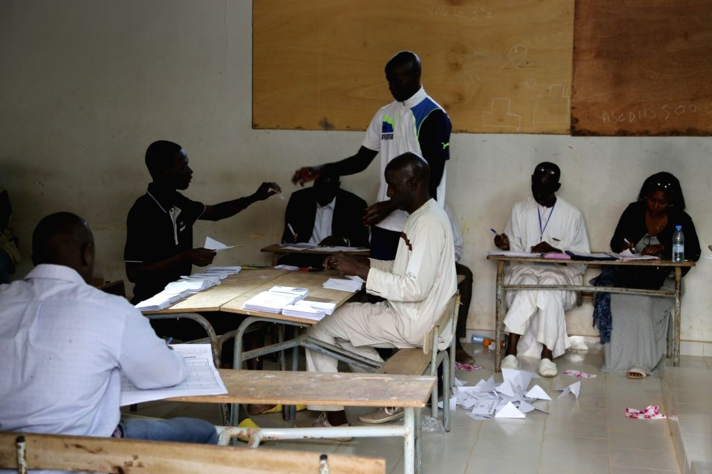 DAKAR, Feb. 24, 2019 - Scrutineers count ballots at a polling station in Dakar, Sanegal, on Feb. 24, 2019. Ballot-counting started immediately after the voting process of the Senegalese presidential ...