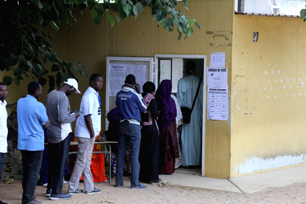 DAKAR, Feb. 24, 2019 - Senegalese voters queue to cast ballots at a polling station in Dakar, Senegal,  on Feb. 24, 2019. Senegalese presidential election started Sunday at 08:00 local time (08:00 ... - Idrissa Seck