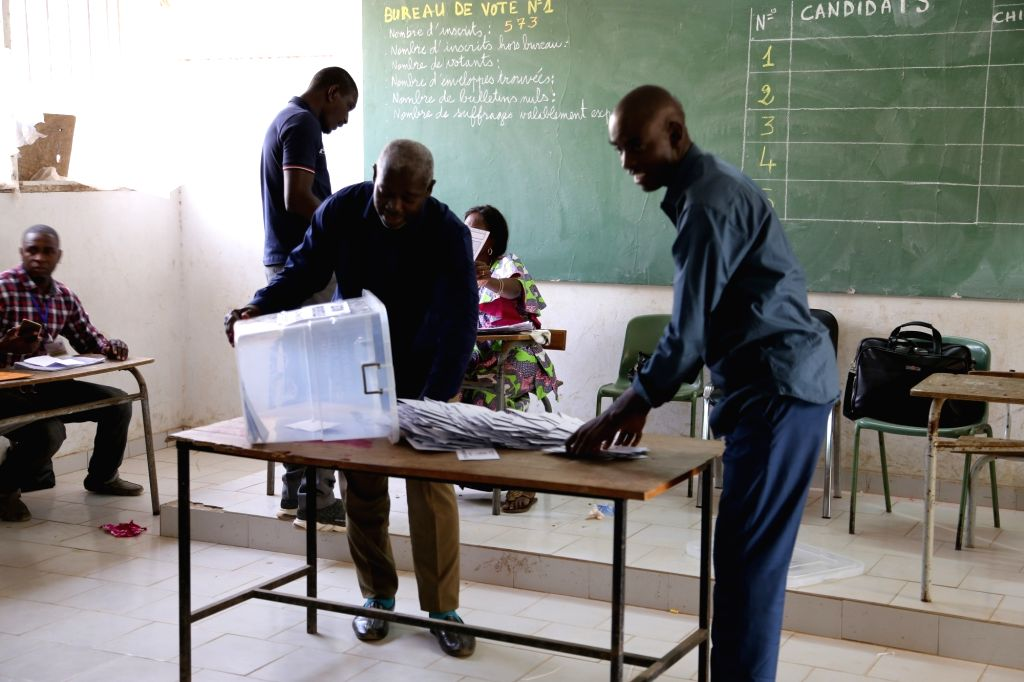DAKAR, Feb. 24, 2019 - Staff members work at a polling station in Dakar, Sanegal, on Feb. 24, 2019. Ballot-counting started immediately after the voting process of the Senegalese presidential ...