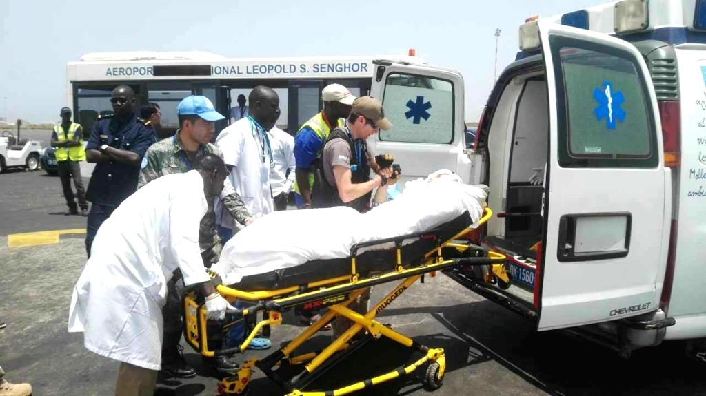 DAKAR, June 1, 2016 - One injured Chinese peacekeeper is carried onto an ambulance after arriving at the airport in Dakar, Senegal, June 1, 2016. China on Wednesday condemned the terrorist attack in ...