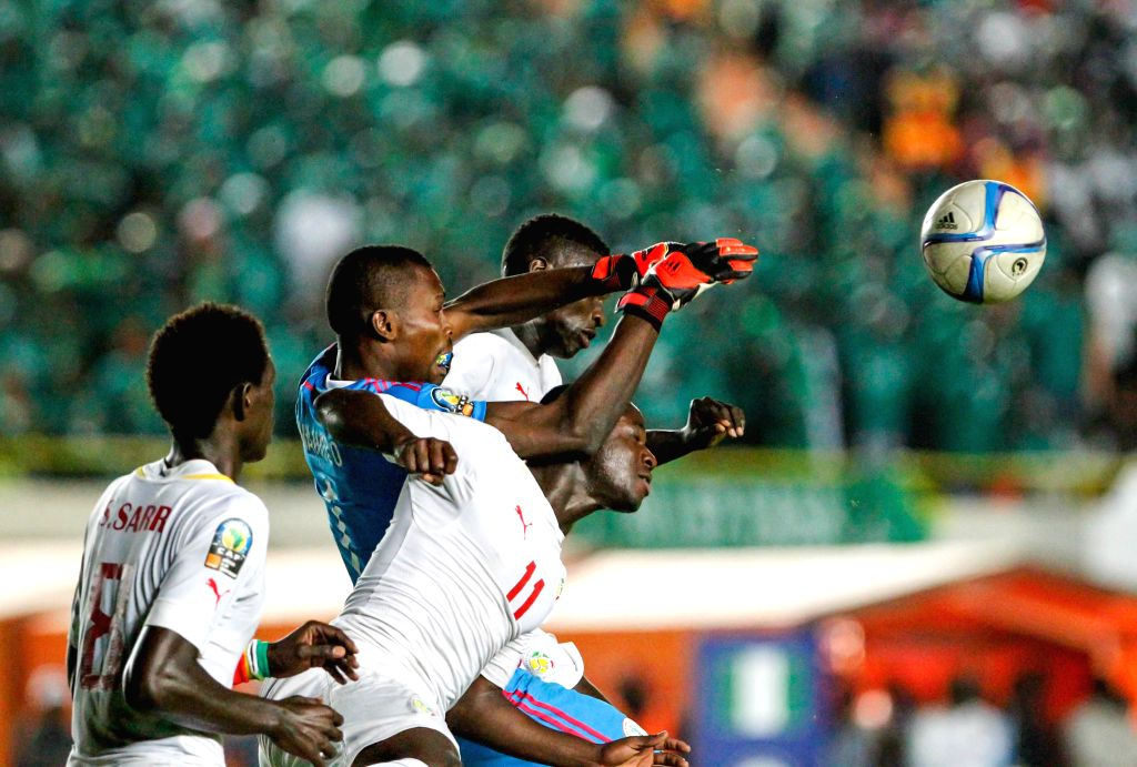 Football players of Senegal and Nigeria vie for the ball during the final of the 2015 African U20 Championship in Dakar, March 22, 2015. Nigeria claims the title by ...