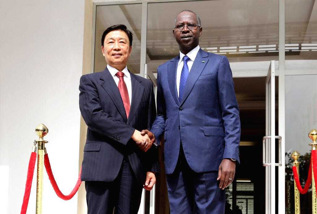 DAKAR, May 8, 2017 - Senegalese Prime Minister Mohammed Dionne (R) meets with visiting Chinese Vice President Li Yuanchao in Dakar, capital of Senegal on May 8, 2017. - Mohammed Dionne