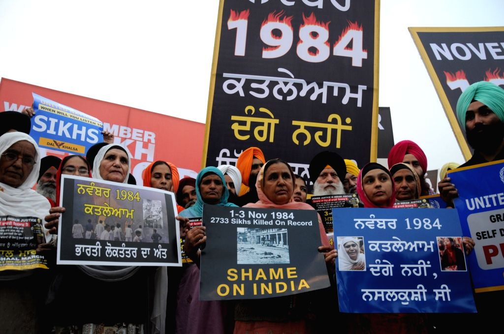 Dal Khalsa activists participate in a 'Mashaal (Torch) March' demanding justice for the victims of the 1984 anti-Sikh riots; in Amritsar on Nov 3, 2018.