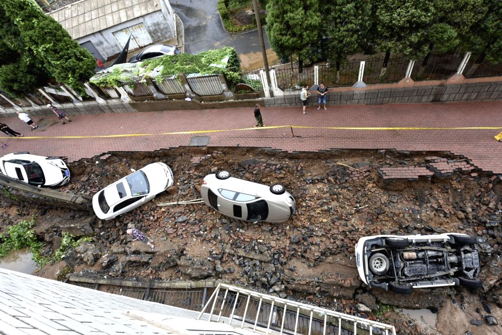 DALIAN, Aug. 4, 2017 - Photo taken on Aug. 4, 2017 shows damaged cars after heavy rain in Shahekou District of Dalian, northeast China's Liaoning Province. Heavy rain hit Dalian from Aug. 2 to Aug. ...