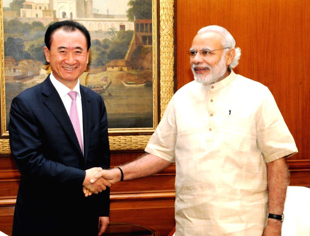 Wang Jianlin calls on Modi