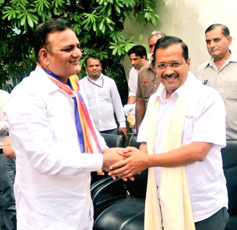 Dalit activist Raj Kumar Anand and Delhi Chief Minister and the party's National Convener Arvind Kejriwal. - Kumar Anand and Convener Arvind Kejriwal