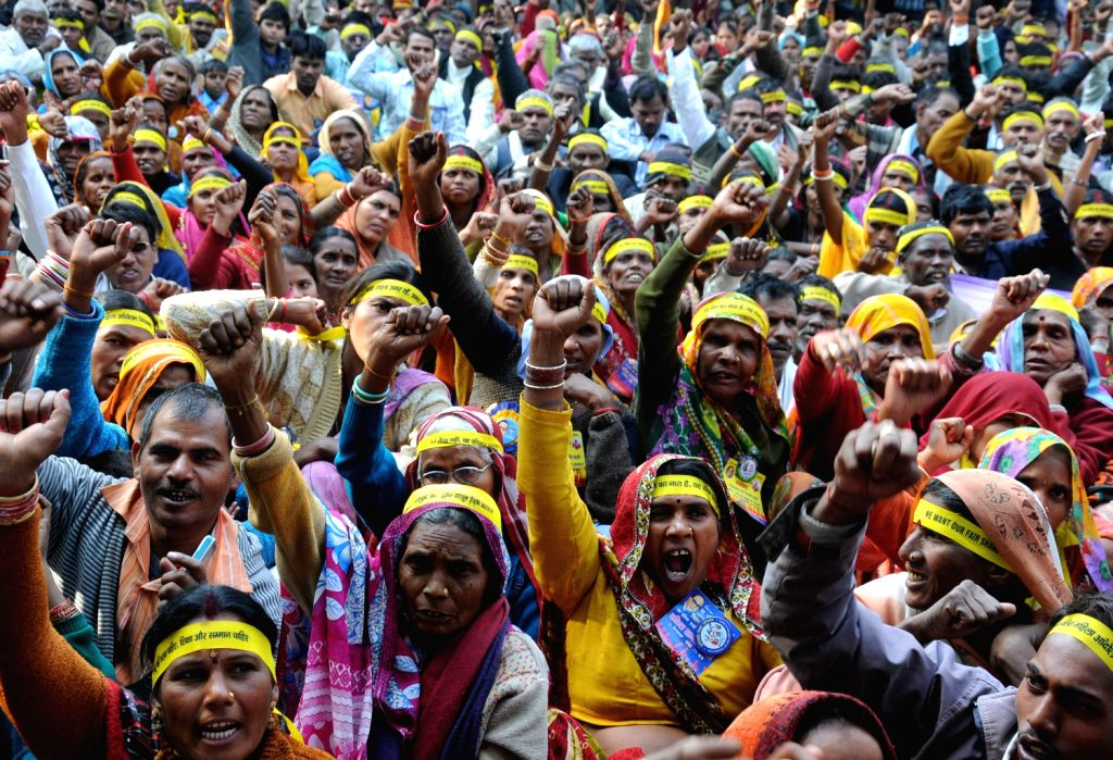 Dalit women shout slogans during a `Dalit Dignity Rally` against Congress-led UPA government near Parliament House demanding equitable share, equal rights and reservation in New Delhi on Dec.6, 2013.