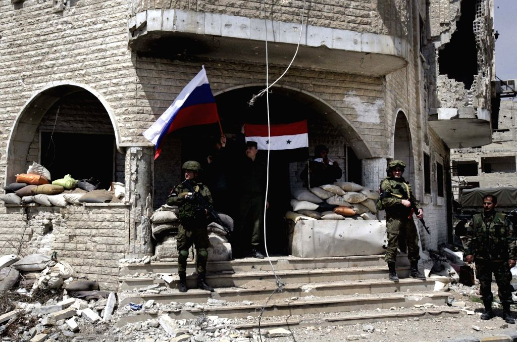 DAMASCUS, April 1, 2018 - Syrian and Russian soldiers stand guard at a military position in the recently recaptured Jobar neighborhood in the Eastern Ghouta countryside of Damascus, Syria, on April ...