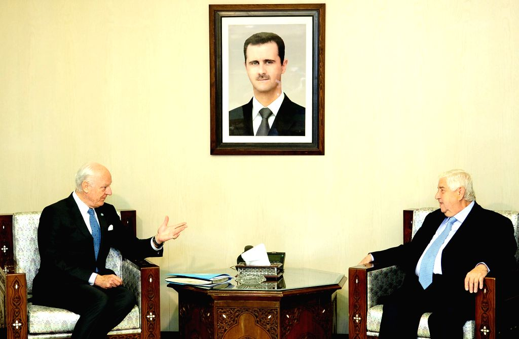 DAMASCUS, April 11, 2016 - United Nations envoy to Syria Staffan De Mistura(L) meets with Syrian Foreign Minister Walid al-Moallem in  Damascus, capital of Syria on April 11, 2016. Syrian Foreign ... - Walid