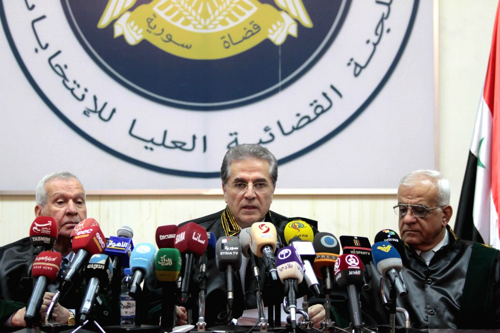 DAMASCUS, April 17, 2016 - Hisham Sha'ar (C), head of the Supreme Judicial Committee for Elections, speaks at a press conference in Damascus, Syria on April 16, 2016. The Syrian higher electoral ...