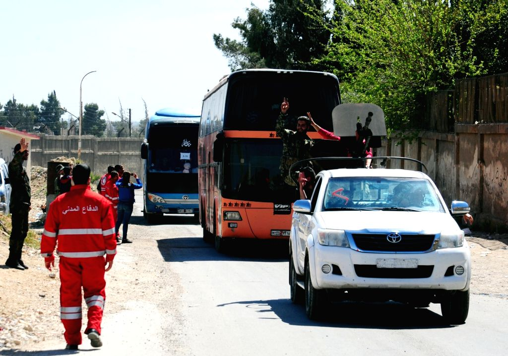 DAMASCUS, April 2, 2018 - Buses transporting militants of the Islam Army and their families leave the district of Douma in Eastern Ghouta through a crossing point in Wafideen area, northeast of ...