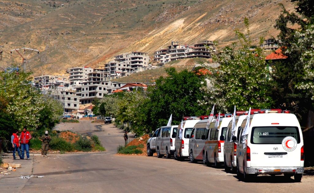 DAMASCUS, April 21, 2016 - Ambulances of the Syrian Arab Red Crescent (SARC) wait on the outskirts of the rebel-held town of Madaya in northern Damascus, capital of Syria, on April 20, 2016. About ...