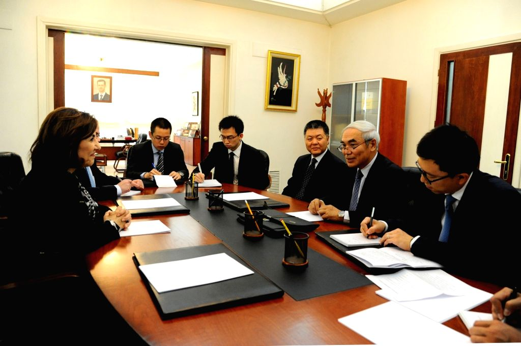DAMASCUS, April 21, 2016 - China's envoy to Syria Xie Xiaoyan (2nd R) holds talks with Syria's Presidential Political and Media Advisor, Buthaina Shaba'an (1st L) in Damascus, capital of Syria, on ...