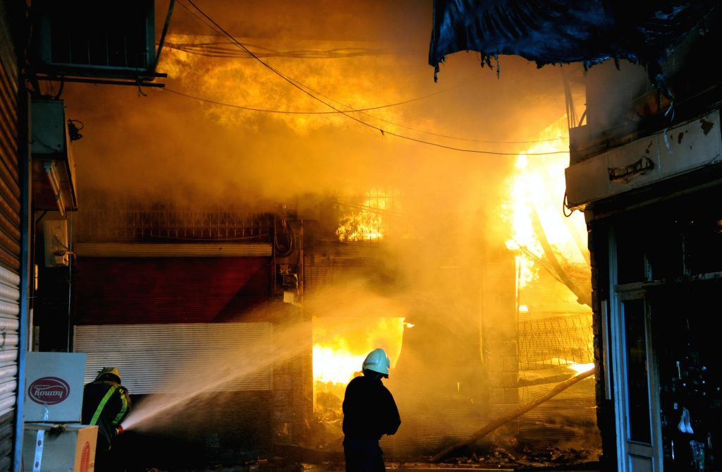 DAMASCUS, April 23, 2016 - A firefighter tries to extinguish a blazing fire that has engulfed the ancient market of Al-Assroniyah marketplace, which is located between the historic citadel and the ...