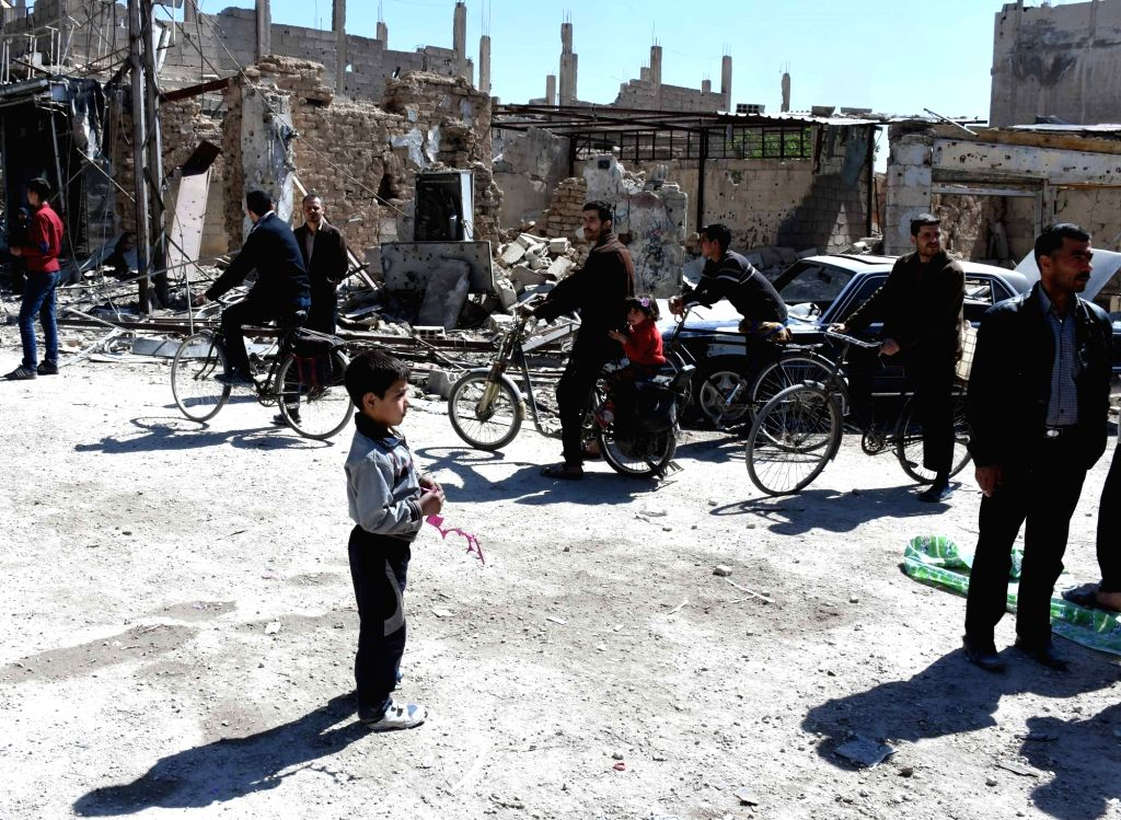 DAMASCUS, April 3, 2018 - A boy stands in a street in the town of Arbeen in the Eastern Ghouta countryside of Damascus, Syria, on April 2, 2018. The last batch of rebels left the towns of Jobar, ...