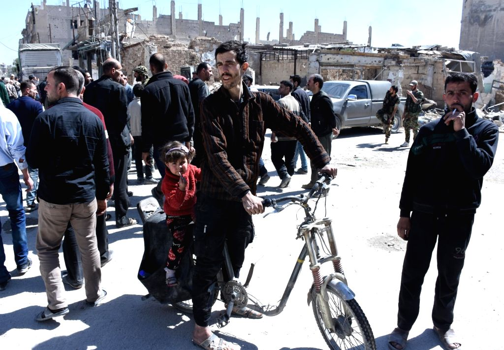 DAMASCUS, April 3, 2018 - People gather in a street in the town of Arbeen in the Eastern Ghouta countryside of Damascus, Syria, on April 2, 2018. The last batch of rebels left the towns of Jobar, ...