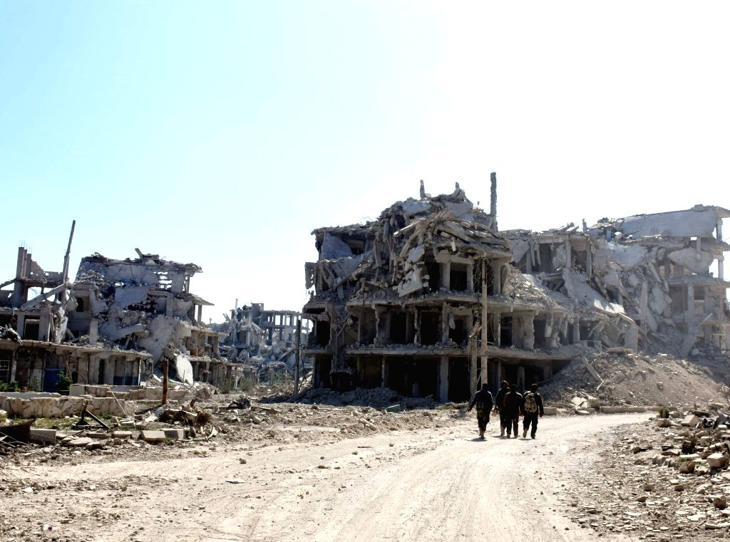 DAMASCUS, April 3, 2018 - People walk on a road in the town of Arbeen in the Eastern Ghouta countryside of Damascus, Syria, on April 2, 2018. The last batch of rebels left the towns of Jobar, Arbeen, ...