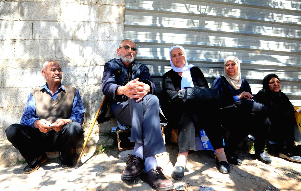 DAMASCUS, April 4, 2018 - Families of kidnapped people wait for their relatives to be released at the Wafideen crossing, northeast of Damascus, Syria, on April 4, 2018. Five kidnapped people were ...