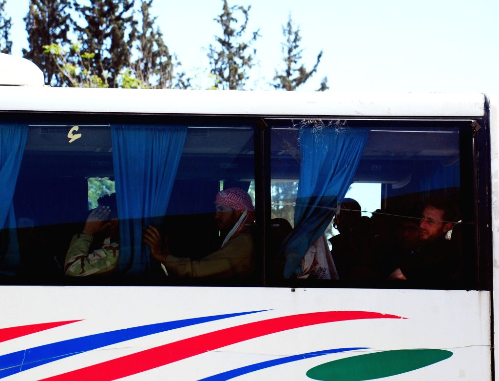 DAMASCUS, April 4, 2018 - Islam Army militants and their families arrive by bus at the Wafideen crossing, northeast of Damascus, Syria, on April 4, 2018. A total of 635 Islam Army militants and their ...