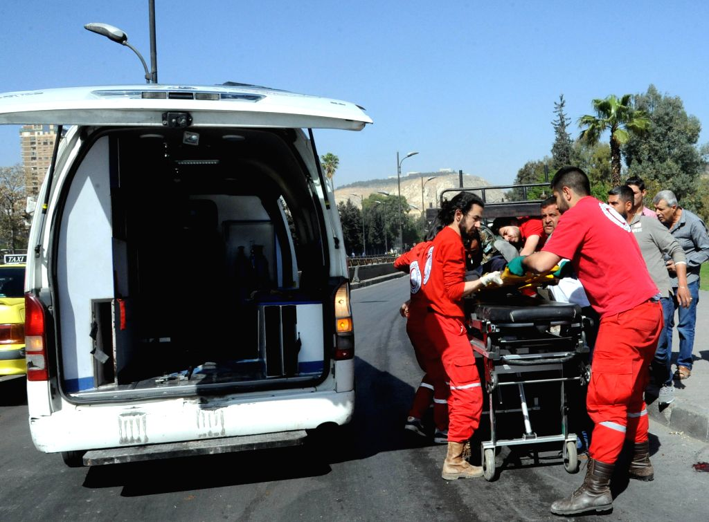DAMASCUS, April 7, 2018 - Red Crescent paramedics evacuate wounded people in Damascus, capital of Syria, on April 7, 2018. Five civilians were killed and 30 others wounded Saturday by the rebels' ...