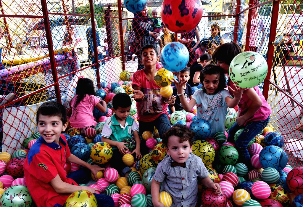 DAMASCUS, Aug. 14, 2019 - Children enjoy their time during the four-day holiday of the Eid al-Adha in Damascus, Syria,  Aug. 13, 2019.
