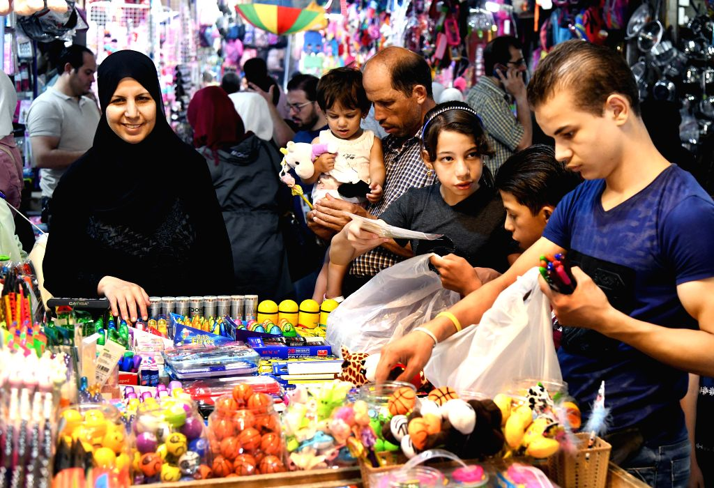 DAMASCUS, Aug. 27, 2019 - Syrians buy school supplies ahead of a new school year in Damascus, Syria, on Aug. 27, 2019.