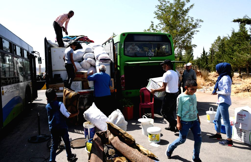DAMASCUS, Aug. 29, 2019 - Syrian refugees unload belongings after they arrived at the Jdeidet Yabous border crossing, west of Damascus, Syria, on Aug. 29, 2019. Around 960 Syrian refugees on Thursday ...