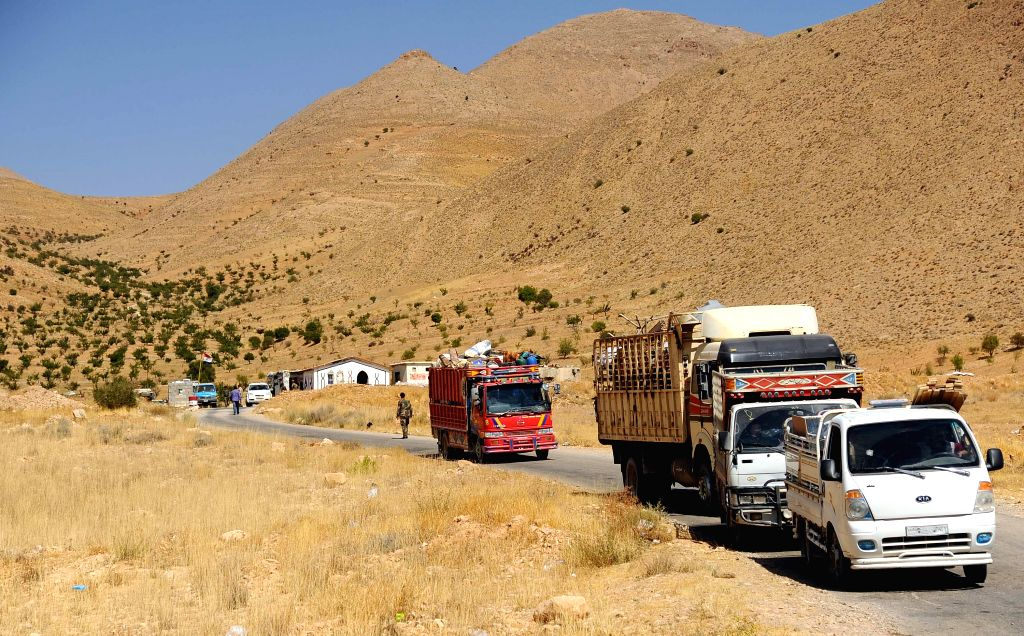DAMASCUS, Aug. 29, 2019 - Vehicles carrying Syrian refugees are seen at the Zamarani border crossing, north of Damascus, Syria, on Aug. 29, 2019. Around 960 Syrian refugees on Thursday returned from ...