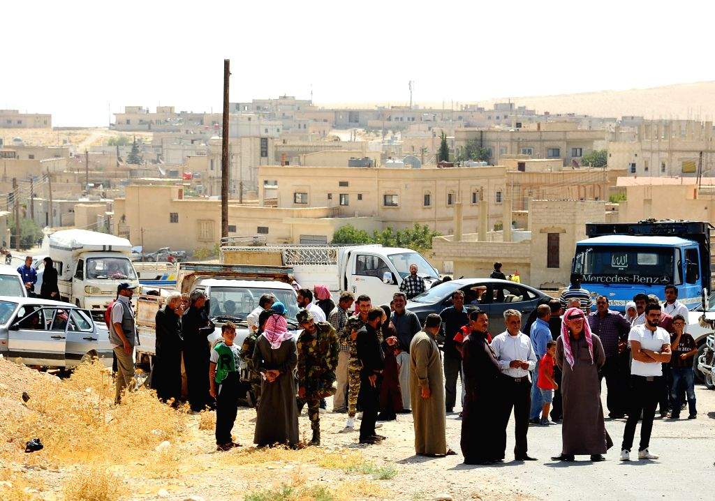 DAMASCUS, Aug. 29, 2019 (Xinhua) -- Syrian refugees arrive at the Zamarani border crossing, north of Damascus, Syria, on Aug. 29, 2019. Around 960 Syrian refugees on Thursday returned from Lebanon to Syria, the National News Agency reported. (Xinhua/