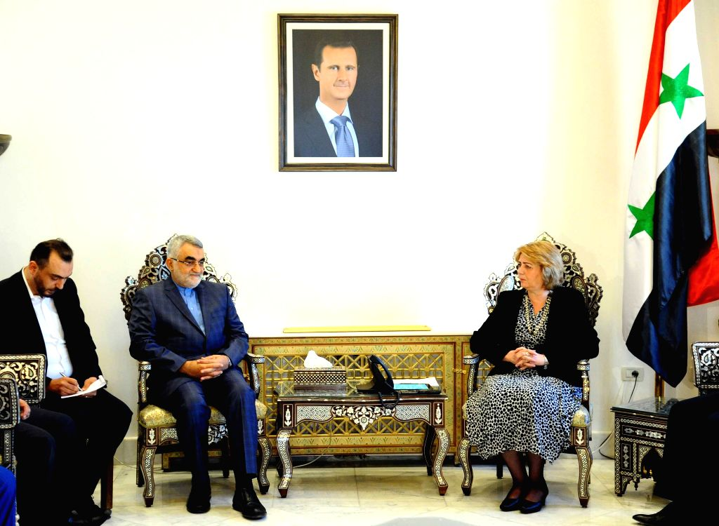 DAMASCUS, Aug. 4, 2016 - Speaker of the Syrian parliament Hadiyeh Abbas (R) meets with visiting Chairman of the Iranian Shura Council's Committee for Foreign Policy and National Security Alaeddin ...