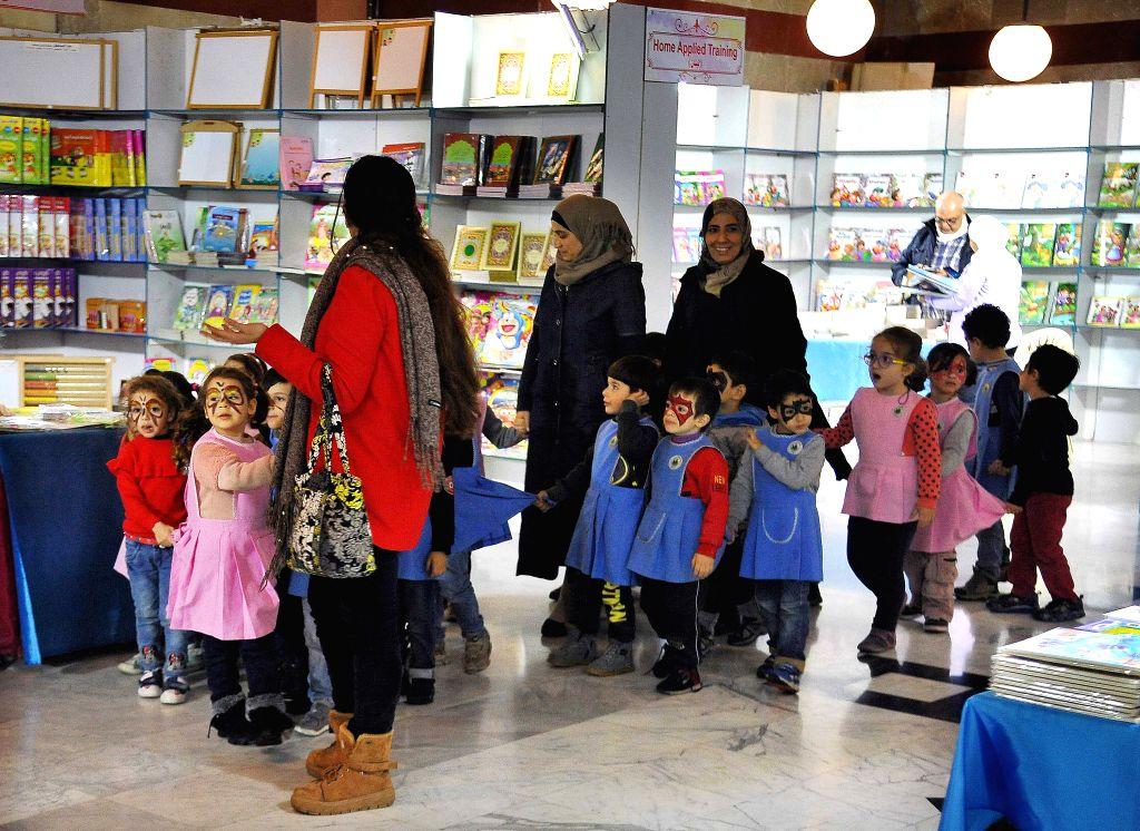 DAMASCUS, Dec. 5, 2019 - School children visit a book fair for children in Damascus, Syria, on Dec. 5, 2019. The Syrian Ministry of Culture held a book fair for children on Thursday.