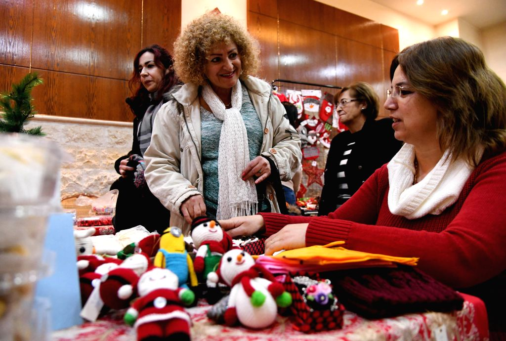 DAMASCUS, Dec. 5, 2019 - Syrians attend a Christmas bazaar in Damascus, Syria, on Dec. 5, 2019. Around 40 women showcased their handmade Christmas decorations in the bazaar with the aim of raising ...