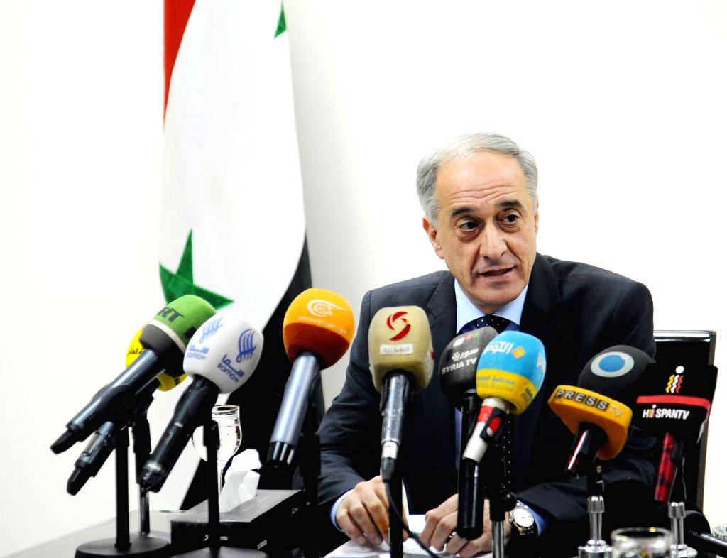 DAMASCUS, Feb. 13, 2018 - Ayman Soussan, an assistant of Syria's Foreign Minister, speaks at a press conference in Damascus, Syria, Feb.13, 2018. The Syrian government said Tuesday it rejects any ...