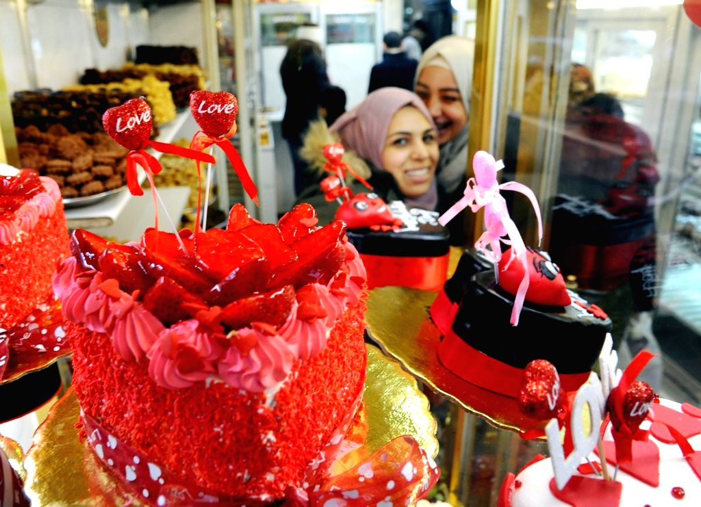 DAMASCUS, Feb. 13, 2018 - Heart-shaped cakes are displayed in a shop a day ahead of the Valentine's Day in Damascus, capital of Syria, on Feb. 13, 2018.