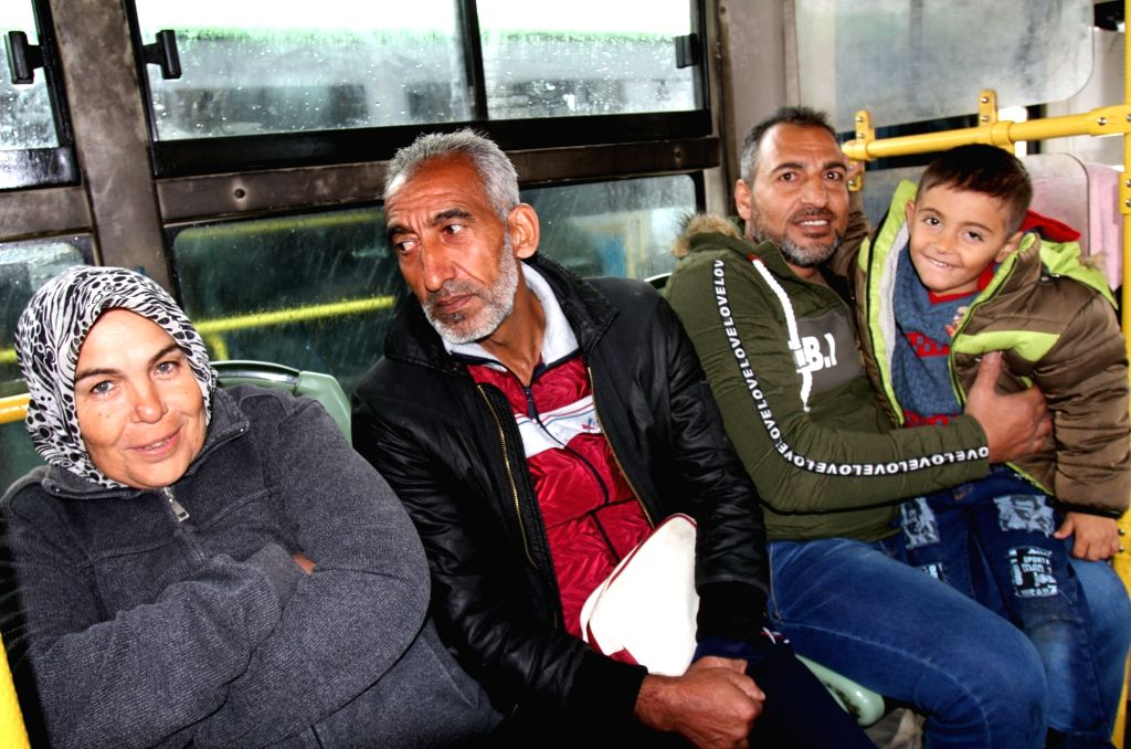 DAMASCUS, Feb. 28, 2019 - Syrian refugees are seen in a bus upon their arrival at the Jdaidet Yabous crossing, west of Damascus, Syria, on Feb. 28, 2019. Hundreds of Syrian refugees returned from ...