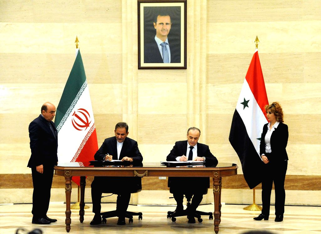 DAMASCUS, Jan. 29, 2019 - Syria's Prime Minister Emad Khamis (2nd R) and Iranian First Vice President Eshaq Jahangiri (2nd L) sign economic agreements in Damascus on Jan. 28, 2019. - Emad Khamis