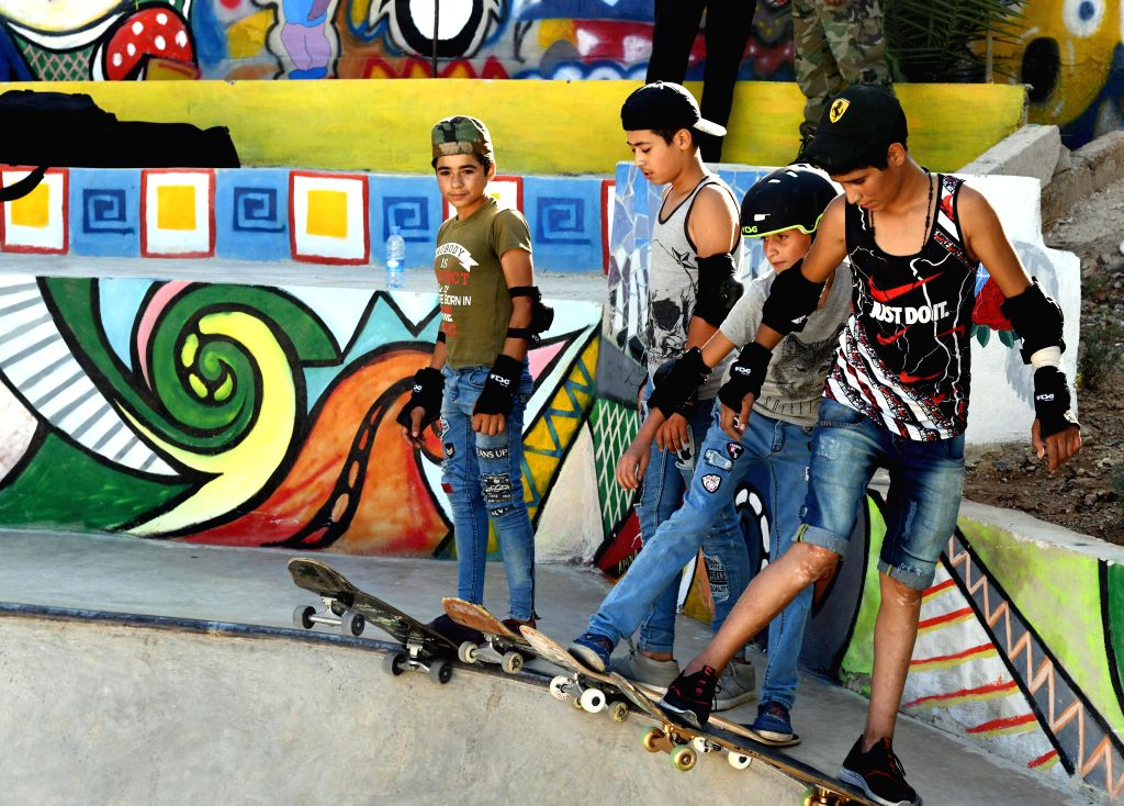 DAMASCUS, July 17, 2019 - Boys skateboard during the opening of the first skatepark in Damascus, Syria, July 15, 2019. The skatepark was co-built by SOS Children's Villages in Syria, the German Skate ...