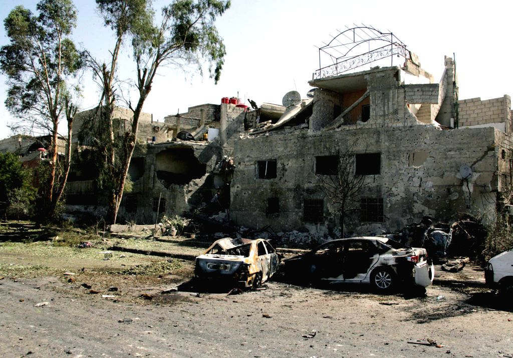 DAMASCUS, July 2, 2017 - Destruction scene is seen near the airport road in Damascus, capital of Syria, on July 2, 2017. A car bomb rocked the Tahrir Square in the capital and two cars exploded near ...