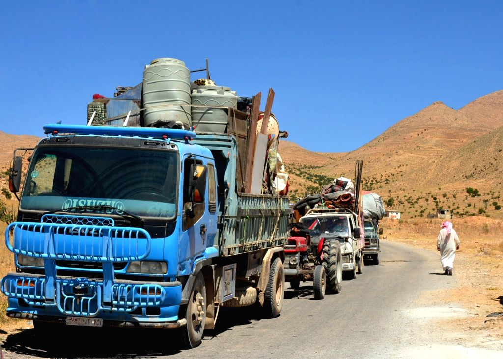 DAMASCUS, July 23, 2018 - Vehicles transporting Syrian refugees and their belongings are seen crossing the Syria-Lebanon border in Qalamoun, north of Damascus, capital of Syria, on July 23, 2018. ...