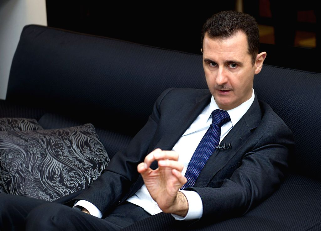 DAMASCUS, June 19, 2013 (Xinhua/IANS) -- Syrian President Bashar al-Assad receives an interview by Germany's Frankfurter Allgemeine Zeitung newspaper in Damascus, Syria, June 17, 2013.(Xinhua/SANA) (srb)