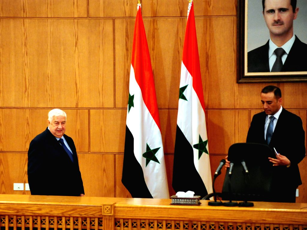 DAMASCUS, June 2, 2018 - Syria's Foreign Minister Walid al-Moallem (L) arrives to address a press conference in Damascus, Syria, on June 2, 2018. Walid al-Moallem said on Saturday that the U.S. ... - Walid
