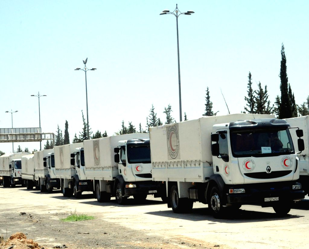 DAMASCUS, June 30, 2016 - Aid convoys enter a war-ravaged town in eastern Ghouta countryside east of Damascus, capital of Syria, on June 29, 2016. Aid convoys entered on Wednesday into two besieged ...