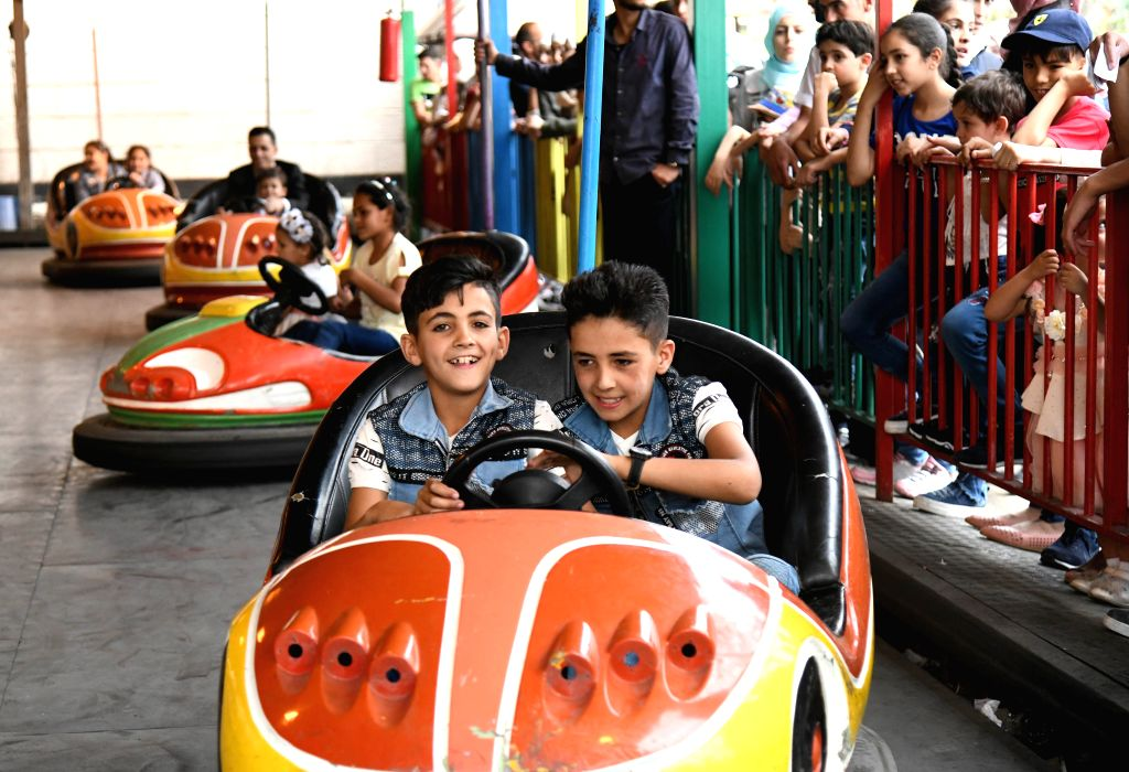 DAMASCUS, June 7, 2019 - Children play in an amusement park on the occasion of the Eid al-Fitr feast in Damascus, Syria, on June 6, 2019.