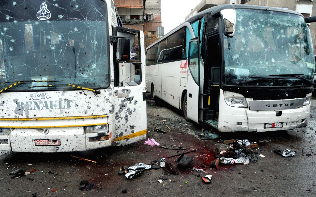 DAMASCUS, March 11, 2017 - Photo taken on March 11, 2017 shows scene after blasts targeting Iraqi Shiite visitors in Damascus, capital of Syria. At least 40 people were killed and 100 others wounded ...