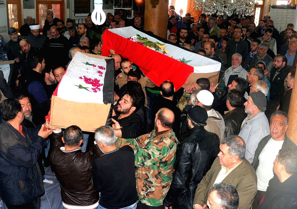 DAMASCUS, March 12, 2017 - Syrians take part in the funeral procession of slain Syrian soldiers in Shaghour area in Damascus, capital of Syria, on March 12, 2017. Two bombings rocked Shaghour area on ...