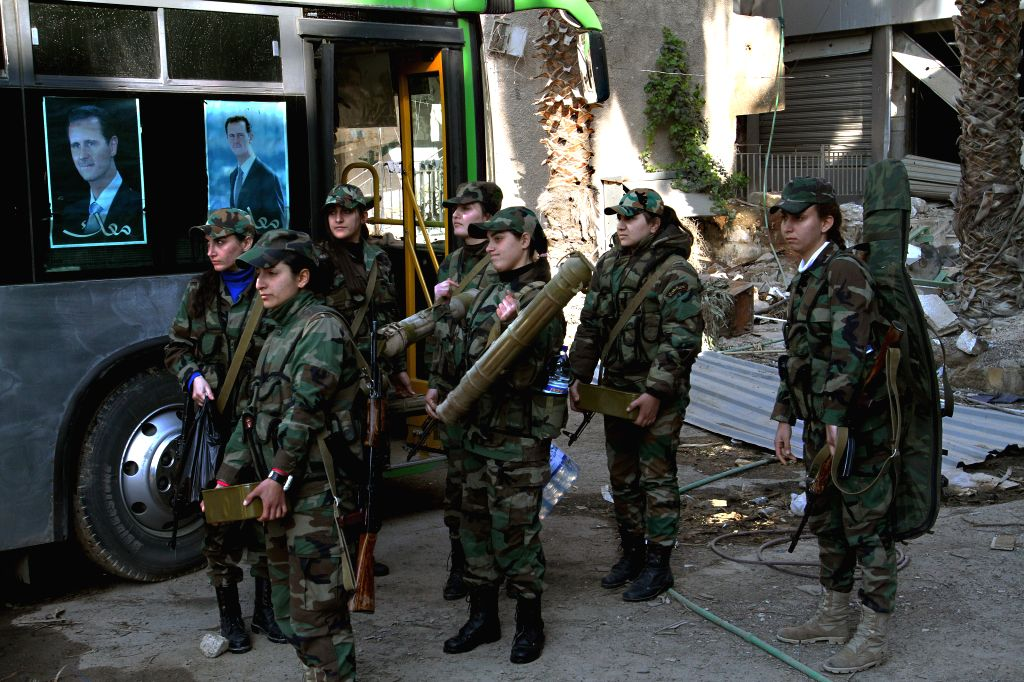 Syrian fighters, members of the Girls Commando Battalion, gather before taking position at the demarcation lines in the Eastern Ghouta in the countryside of ...