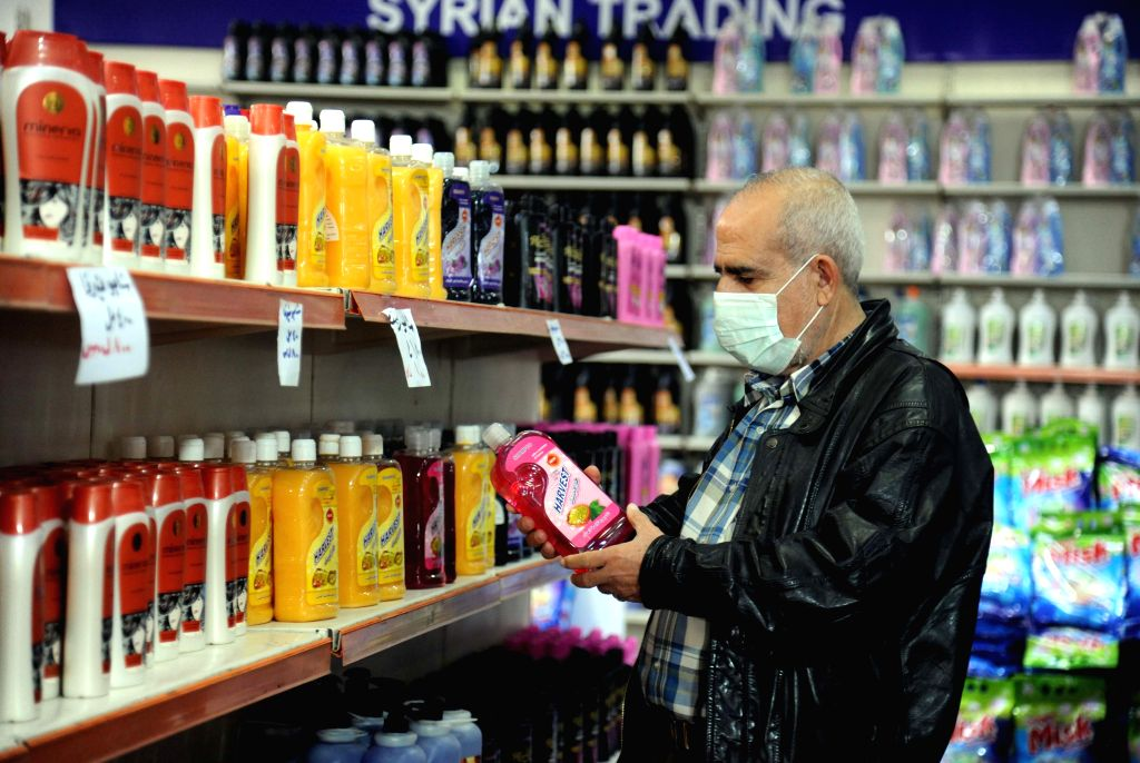 DAMASCUS, March 20, 2020 (Xinhua) -- A man buys cleaning products in Damascus, Syria, on March 19, 2020. The Syrian authorities carry out daily cleaning campaign, using sanitizers to clean public transportations, parks, and pedestrian bridges in the