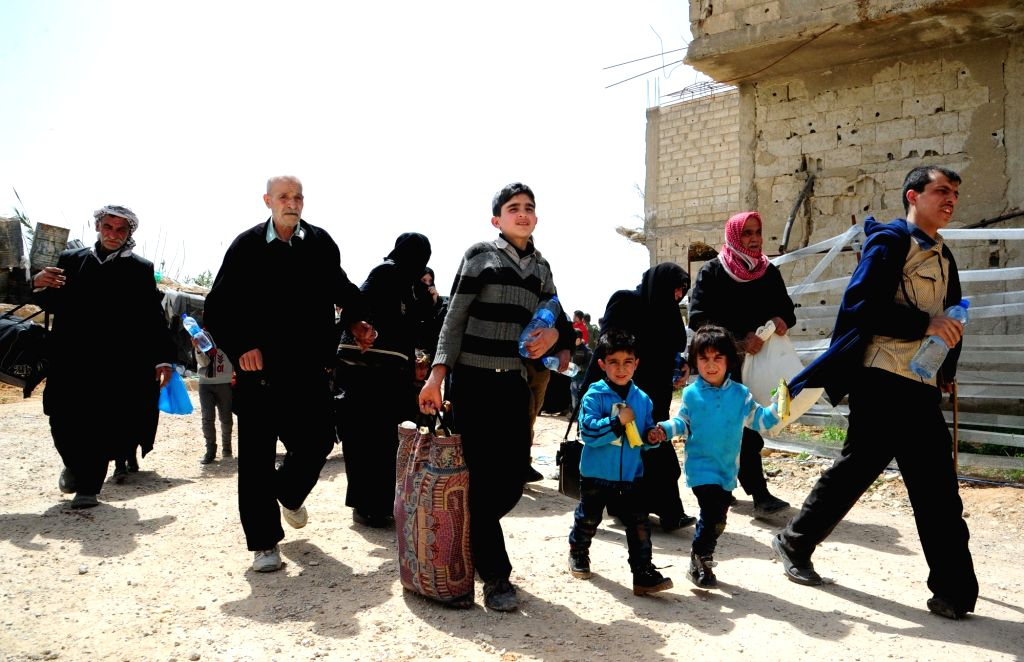 DAMASCUS, March 27, 2018 - Civilians arrive to government-controlled Wafidin area, northeast of Damascus, Syria, on March 27, 2018. Hundreds of civilians evacuated the Douma district in the capital ...